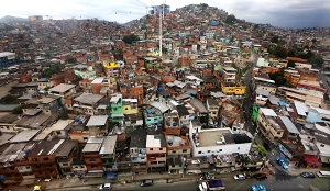 Brazil's Growth Pushes Urbanization Rate Towards 90 Percent...RIO DE JANEIRO, BRAZIL - OCTOBER 08: The Alemao shanty town is viewed from the Teleferico gondola line on October 8, 2013 in Rio de Janeiro, Brazil. The formerly violent hillside 'favela' community recently received the cable car system in an attempt to integrate the community with the surrounding city. Brazil, the fifth largest country in the world geographically, has seen its urban population increase to 87 percent, the highest among the BRIC countries. Some forecasts are calling for Brazil to hit 90 percent urbanization by 2020 as the rural to urban migration continues. By comparison, India's urban population is 31 percent, China's 50 percent and Russia's 73 percent, according to the CIA World Factbook.  (Photo by Mario Tama/Getty Images)