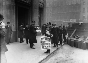 15 Apr 1912, London, England, UK --- A London newsboy sells papers bearing news of the sinking on the day after the disaster. --- Image by © Hulton-Deutsch Collection/CORBIS