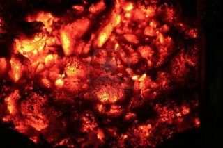 5421350-a-pile-of-red-hot-embers-glowing-in-the-darkness