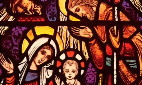 Jesus, Mary and Joseph depicted in stained glass
