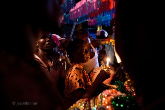 Dominican Republic: A Vodœ priestess performs a blessing ritual at the compound of Bleo, a Vodœ priest and head of El GaG‡ de San Luis on the outskirts of Santo Domingo.