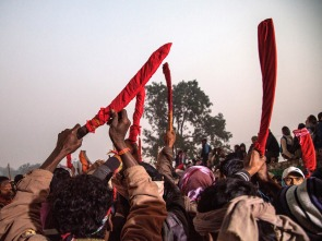BARIYARPUR, NEPAL - NOVEMBER 28: A group of devotees elevate as a blessing their traditional kukri knifes before the beginning of the animal sacrifices during the celebration of the Gadhimai festival on November 28, 2014 in Bariyarpur, Nepal. Over two million people attended this year's Gadhimai festival in Nepal's Bara Disctrict. Held every five years at the Gadhimai temple of Bariyarpur, the festival is the world's largest slaughter of animals, during which between thousands of water buffaloes, pigs, goats, chickens, rats and pigeons are slaughtered in order to please Gadhimai, the Goddess of Power. (Photo by Omar Havana/Getty Images)