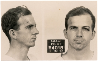 "This handout photo received October 16, 2013 courtesy of RR Auction shows Lee Harvey Oswald's Dallas Police mug shot after he was arrested for the assassination of former US president John F. Kennedy. RR Auction is holding the most extensive JFK auction of the year, fifty years after his tragic assassination in Dallas,Texas on November 22, 1963, offering a collection of museum-quality items relating to John F. Kennedy, his family, and the tragedy of his death. The live auction takes place on October 24, 2013 in Boston, Massachusetts. AFP PHOTO/RR AUCTION/HANDOUT/ RESTRICTED TO EDITORIAL USE - MANDATORY CREDIT ""AFP PHOTO / RR AUCTION / HANDOUT"" - NO MARKETING NO ADVERTISING CAMPAIGNS - DISTRIBUTED AS A SERVICE TO CLIENTSHANDOUT/AFP/Getty Images"