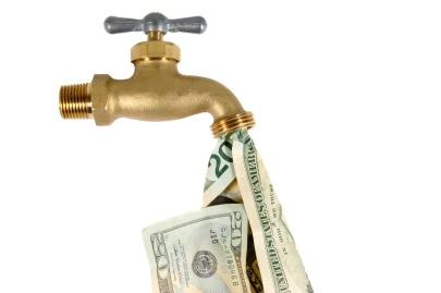 Water tap dripping dollar bills, Water waste concept