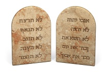 Ten Commandments written on stone tablets in Hebrew