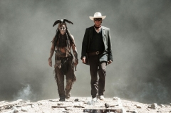 "This undated publicity photo released by Disney and Jerry Bruckheimer, Inc. shows Johnny Depp, left, as Tonto, and Armie Hammer, as The Lone Ranger, in a scene from the film, ""The Lone Ranger."" The movie releases July 3, 2013. (AP Photo/Disney/Jerry Bruckheimer, Inc., Peter Mountain, File)"
