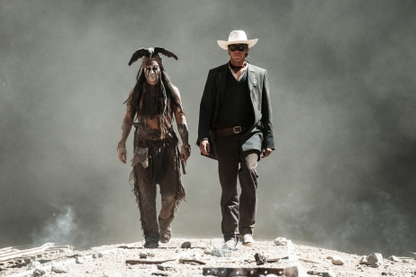 """This undated publicity photo released by Disney and Jerry Bruckheimer, Inc. shows Johnny Depp, left, as Tonto, and Armie Hammer, as The Lone Ranger, in a scene from the film, """"The Lone Ranger."""" The movie releases July 3, 2013. (AP Photo/Disney/Jerry Bruckheimer, Inc., Peter Mountain, File)"""