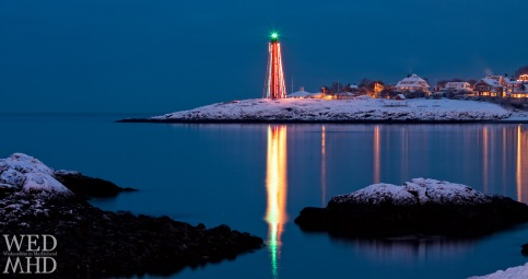 lighthouse reflecting in harbor