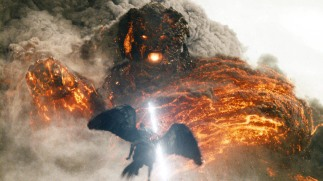 "Perseus, played by SAM WORTHINGTON, battles Kronos in scene from Warner Bros. Pictures' and Legendary Pictures' action adventure ""WRATH OF THE TITANS,"" a Warner Bros. Pictures release."