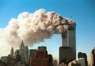 394261 11: Smoke pours from the World Trade Center after it was hit by two hijacjked passenger planes September 11, 2001 in New York City in an alleged terrorist attack. (Photo by Robert Giroux/Getty Images)